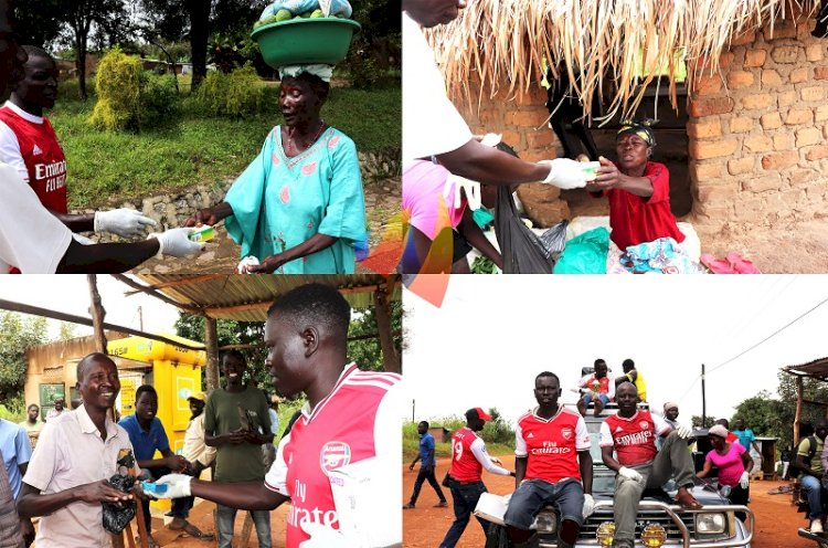 Arsenal fans in Arua city in charity work